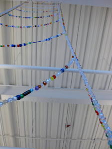 A beaded ladder stretches up to an industrial-looking ceiling at the Nova Scotia College of Art and Design University